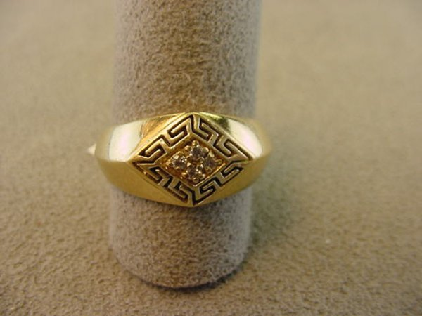 7003: 1 14K GOLD RING SET WITH 4 CLEAR STONES--SIZE 7