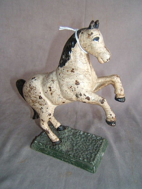 1058: CAST IRON HORSE BANK WITH SPELTER BASE