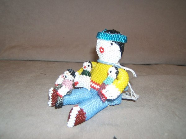 7120: NATIVE AMERICAN BEADED DOLL GROUP