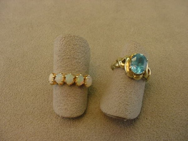 7124: 2 14K GOLD RINGS SET WITH OPALS AND TOPAZ -WORN