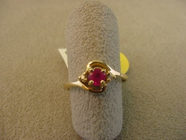 8003: 10K GOLD RUBY AND DIAMOND RING