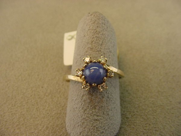 8008: 10K GOLD BLUE STAR SAPHIRE AND DIAMOND RING
