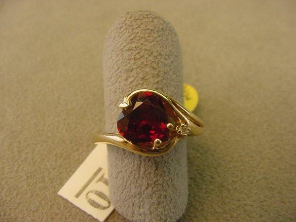 8010: 10K GOLD GARNET AND DIAMOND RING