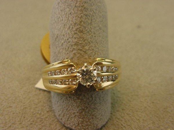 8349: 14K GOLD .32 CT DIAMOND RING