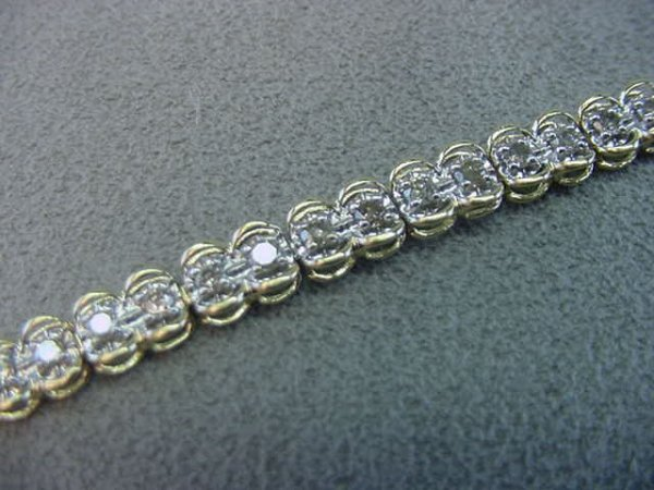 9001: 10K GOLD DIAMOND BRACELET