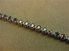 9135: 14K WHITE GOLD BLUE SAPPHIRE AND DIAMOND BRACELET
