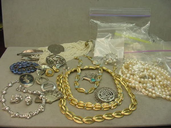 3221: BAG OF COSTUME AND STERLING JEWELRY