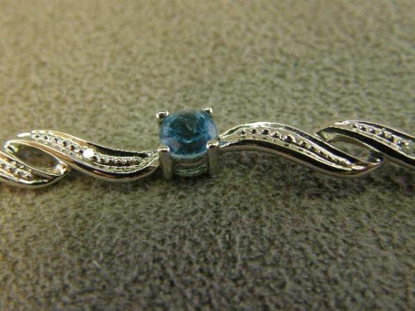 4001: 10K WHITE GOLD BLUE TOPAZ AND DIAMOND BRACELET