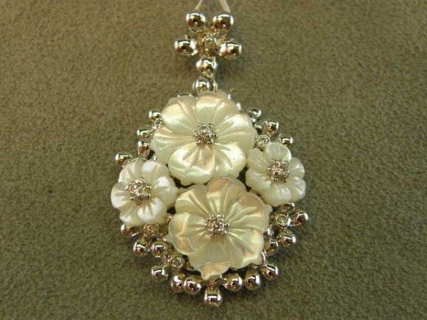 4006: STERLING MOTHER OF PEARL AND STONE FLORAL PENDANT