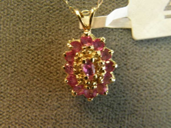 4022: 14K GOLD RUBY AND DIAMOND PENDANT ON CHAIN