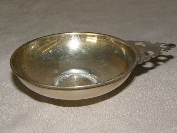 5058: STERLING WINE TASTER WITH 1848 SILVER COIN BASE