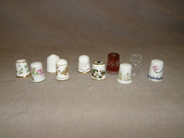 5060: 10 ASSORTED GLASS AND PORCELAIN THIMBLES
