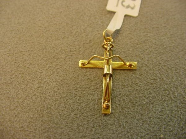 6023: 1 TESTED 18K GOLD CRUCIFIX PENDANT--1 X 3/4 INCH