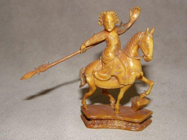 7058: CARVED HORSEBACK MOUNTED IVORY FIGURE