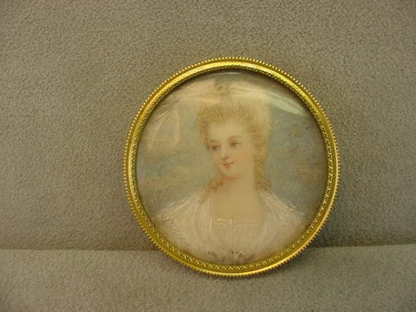 7073: SMALL HANDPAINTED PORTRAIT IN METAL FRAME