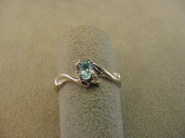 8004: 10K WHITE GOLD BLUE TOPAZ AND DIAMOND RING