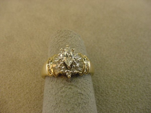 8006: 14K GOLD MARQUISE, ROUND & BAGUETTE DIAMOND RING