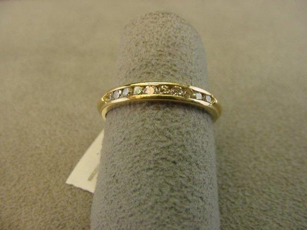 8008: 14K GOLD DIAMOND CHANNEL SET RING