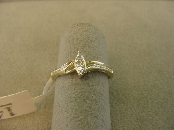 8014: 1 10K GOLD RING SET WITH 3 DIAMONDS SIZE 7 1/4