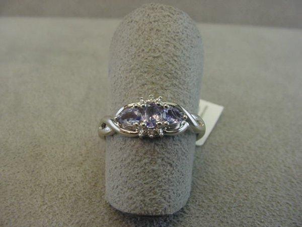 8023: 10K WHITE GOLD TANZANITE AND DIAMOND RING