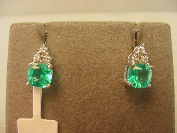 9022: 10K WHITE GOLD EMERALD AND DIAMOND EARRINGS