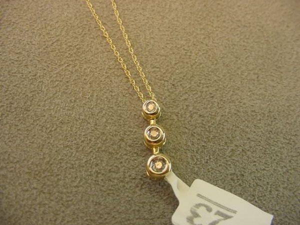 9023: 10K GOLD DIAMOND PENDANT ON CHAIN