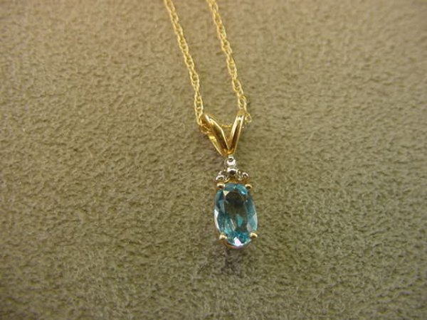 9024: 10K GOLD BLUE TOPAZ AND DIAMOND PENDANT