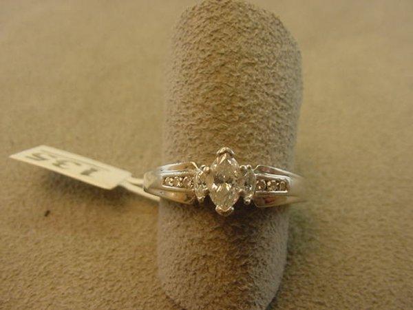 9135: PLATINUM MARQUISE AND ROUND DIAMOND RING