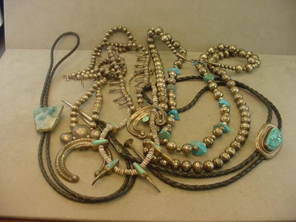 9275: 2 INDIAN SILVER BOLO TIES AND 4 INDIAN NECKLACES