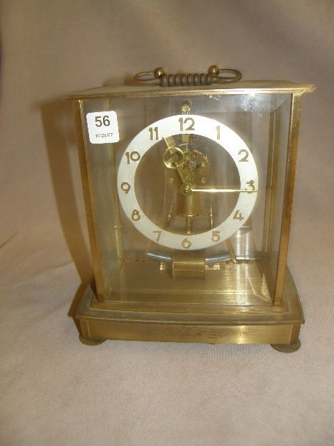1056: GERMAN CLOCK IN BRONZE AND BEVELED GLASS CASE