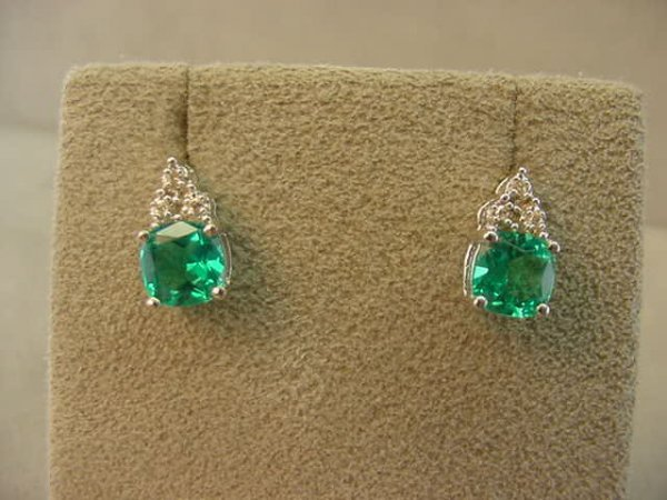 1074: 10K WHITE GOLD EMERALD AND DIAMOND EARRINGS