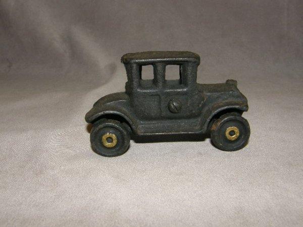2156: SMALL CAST IRON CAR