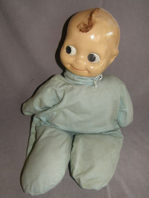 2281: COMPOSITION KEWPIE -LIKE DOLL WITH CLOTH BODY