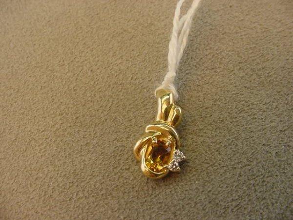 2147: 14K GOLD PENDANT SET WITH CITRINE AND DIAMONDS