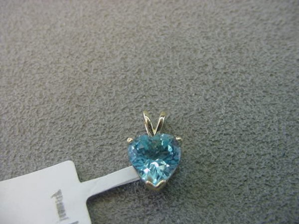 3001: 14K GOLD BLUE TOPAZ HEART DESIGN PENDANT