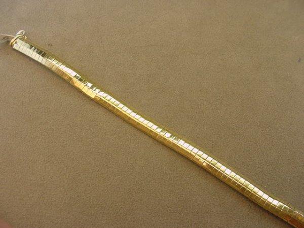 3006: 14K GOLD OMEGA BRACELET