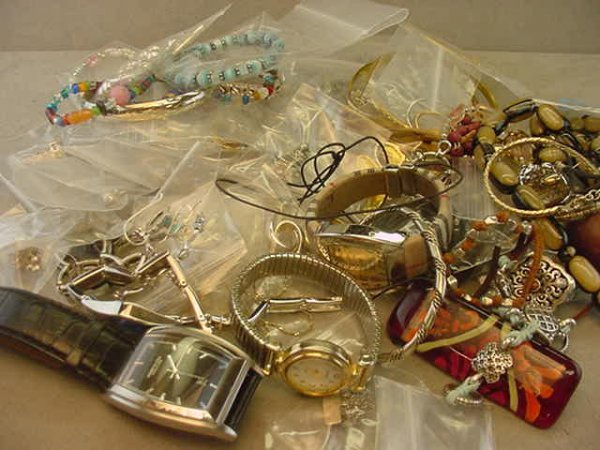 3010: BAG OF ASSORTED COSTUME & SILVER JEWELRY