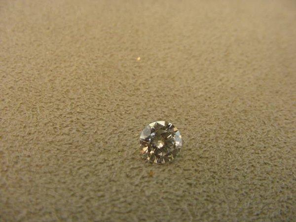 3013: UNSET ROUND .60 CT DIAMOND