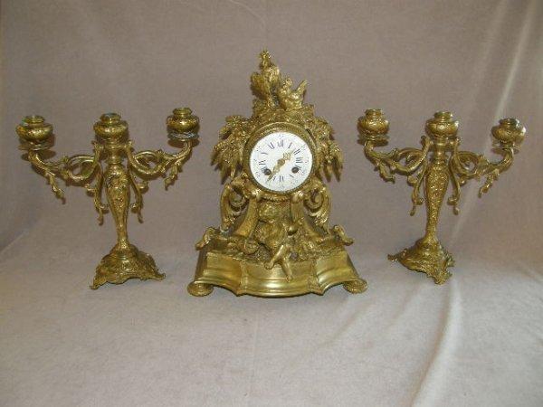 4119: ORNATE BRONZE CASE CLOCK WITH CANDELABRA