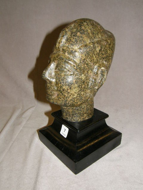 4007: CARVED STONE HEAD ON WOOD BASE