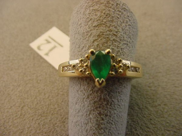 6012: 14K GOLD EMERALD AND DIAMOND RING