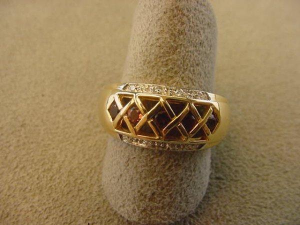 6018: 14K GOLD RHODOLITE GARNET AND DIAMOND RING
