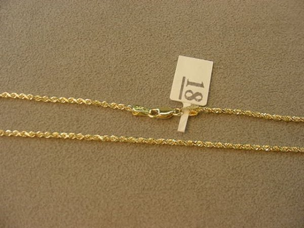 7018: 1 17 INCH 14K GOLD TWISTED ROPE STYLE CHAIN