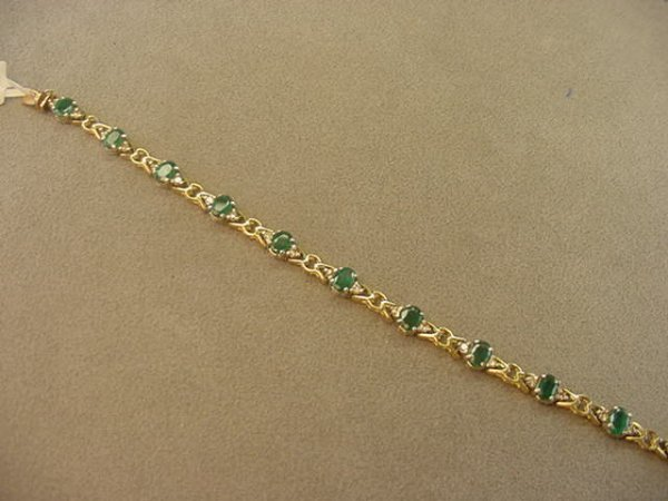 7171: 14K YELLOW AND WHITE GOLD EMERALD & DIA BRACELET