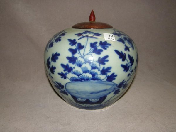 8019: ORIENTAL PORCELAIN JAR WITH WOOD COVER