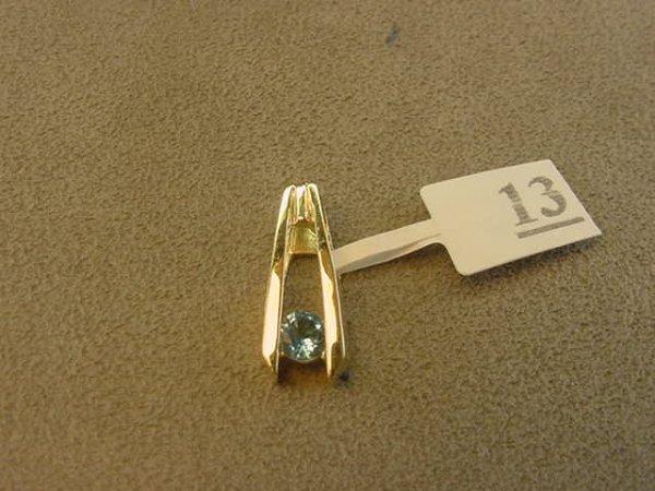 4013: 14K GOLD BLUE TOPAZ PENDANT