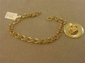4304: 14K GOLD BRACELET WITH ATTACHED TELEPHONE CHARM