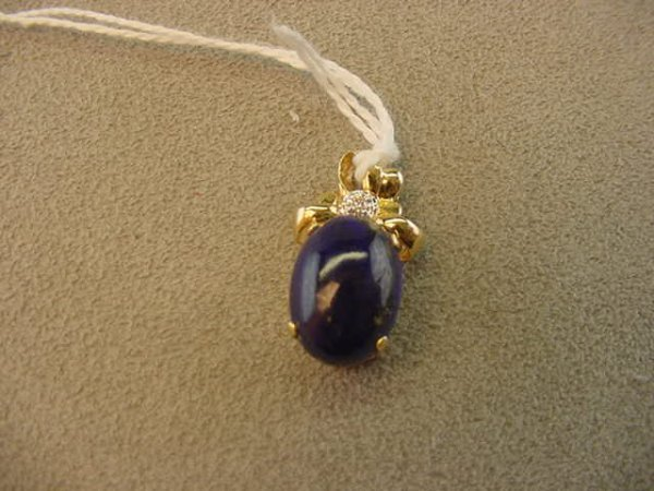 3198: 14K GOLD PENDANT SET WITH LAPIS AND DIAMOND