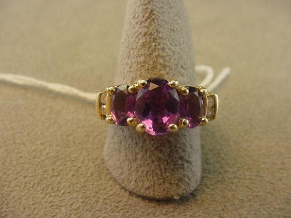 3199: 10K GOLD RING SET WITH 3 AMETHYST AND 4 DIAMONDS