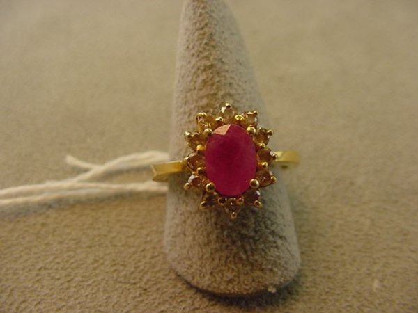 3200: TESTED 14K GOLD RING SET WITH RUBY AND DIAMONDS